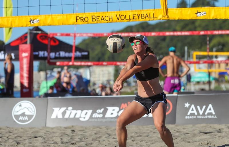 beach volleyball tournament girls in bikinis & shorts