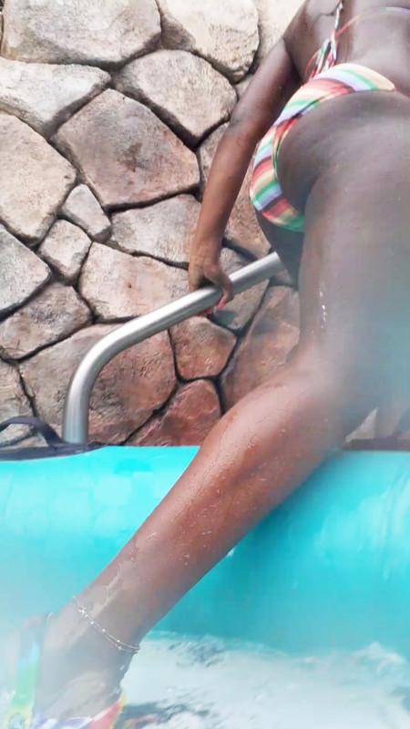 hot young ebony lady in wet bikini