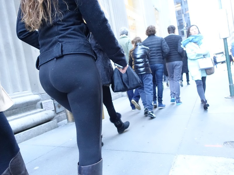 candid booty in black leggings & boots