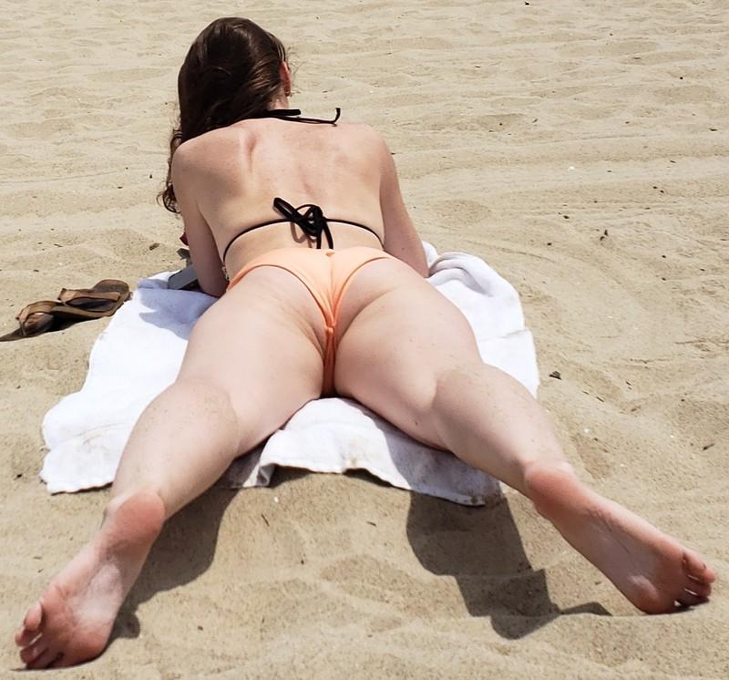 beach sunbather lady in candid bikini