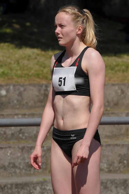 track & field blonde at high jump & running