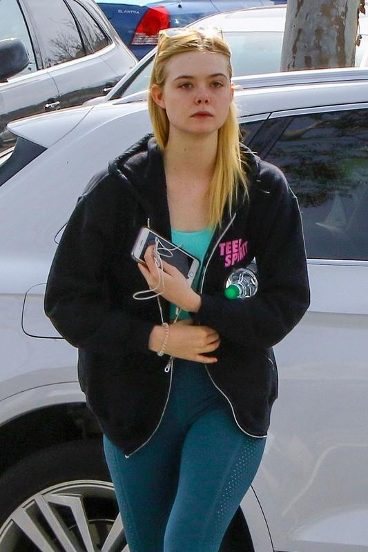 sporty chick Elle Fanning in teal leggings