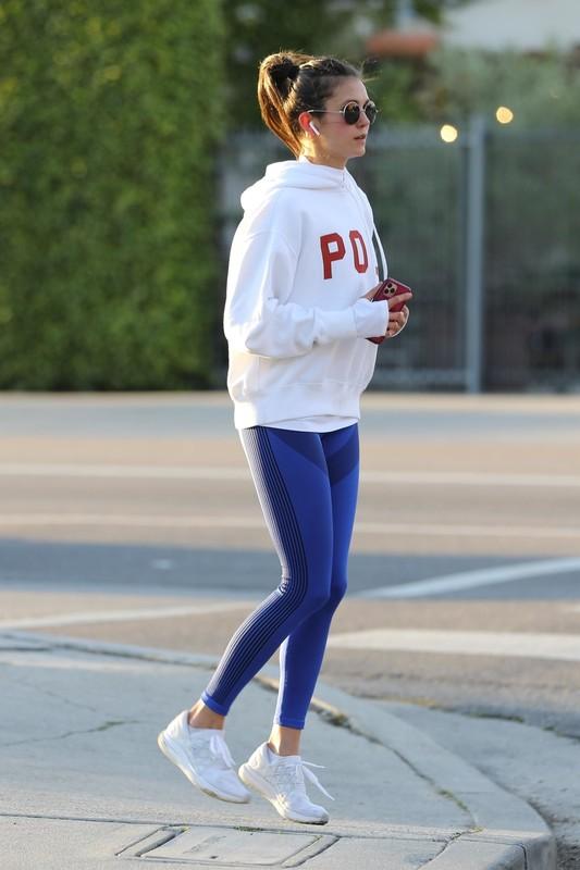 sexy jogger Nina Dobrev in blue leggings