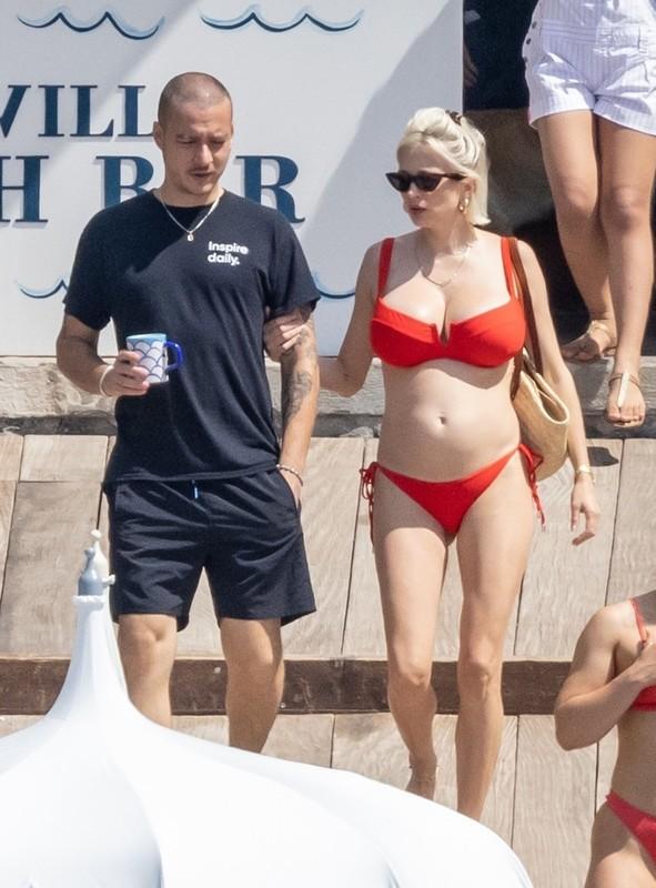 busty blonde milf Caroline Vreeland in red bikini