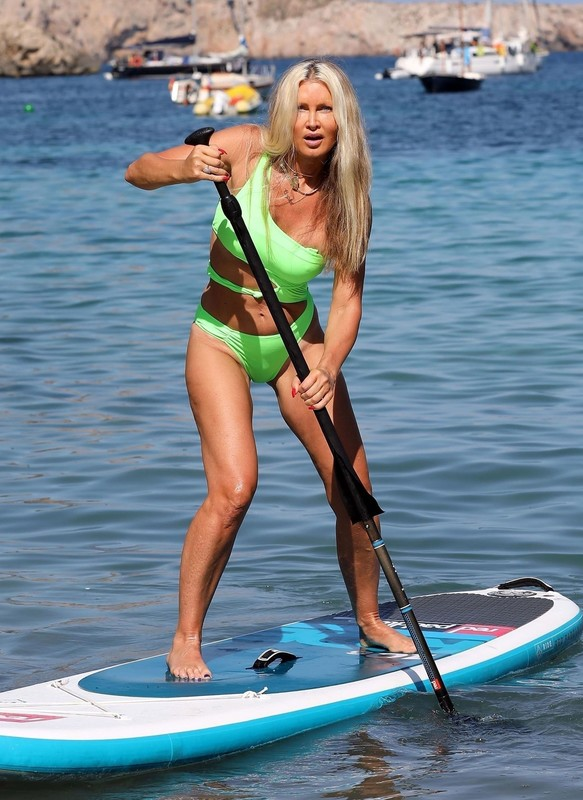 lovely blonde milf Caprice Bourret in green swimsuit