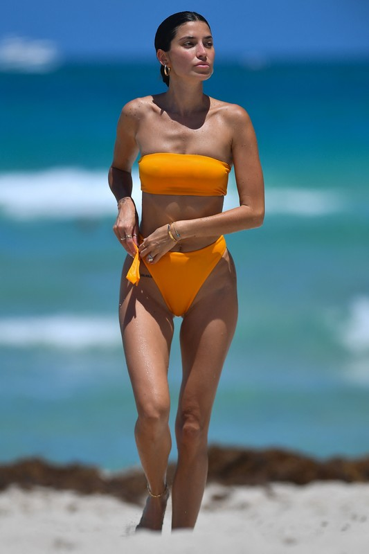 gorgeous lady Nicole Williams in a strapless orange thong swimsuit