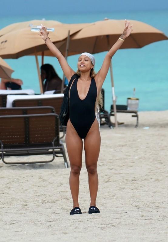 beautiful babe Karrueche Tran in black one piece swimsuit