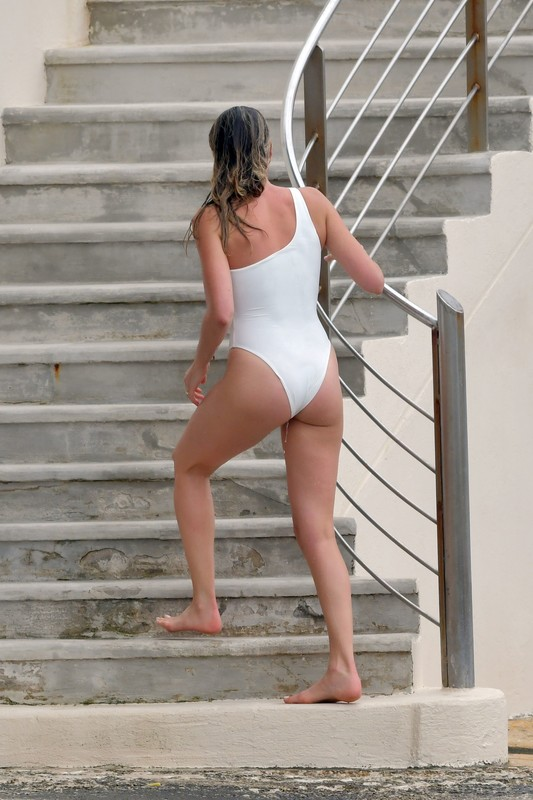diver babe Margot Robbie in white one piece swimsuit