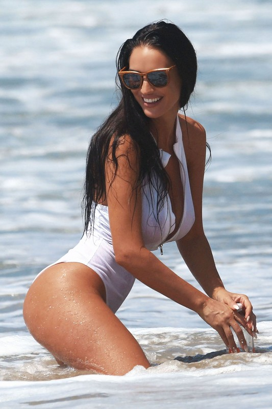 busty lady Charlie Riina in wet 1 piece swimsuit