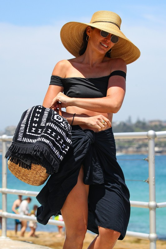classy milf Jodi Gordon in black retro style bikini