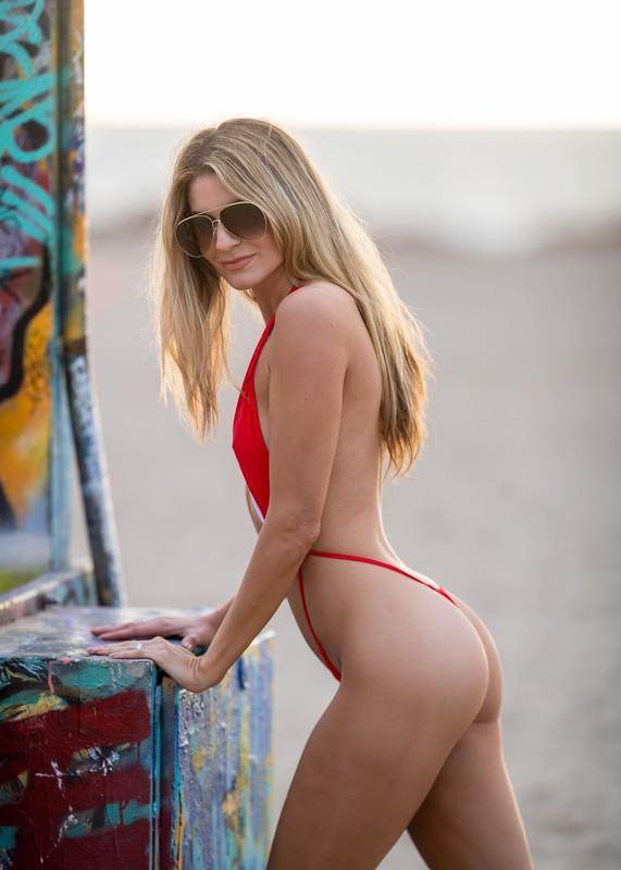 blonde model Rachel McCord in naughty red swimsuit