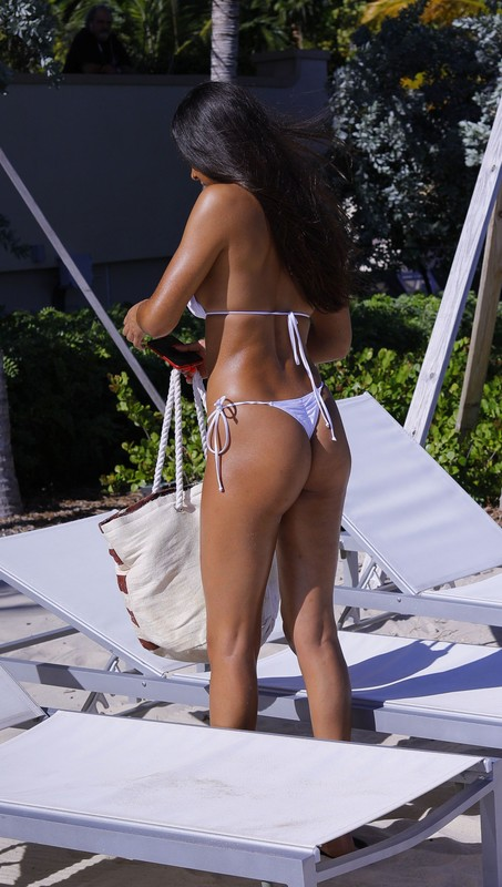 sexy brunette chick Rebecca 'Becca' Scott in white bikini