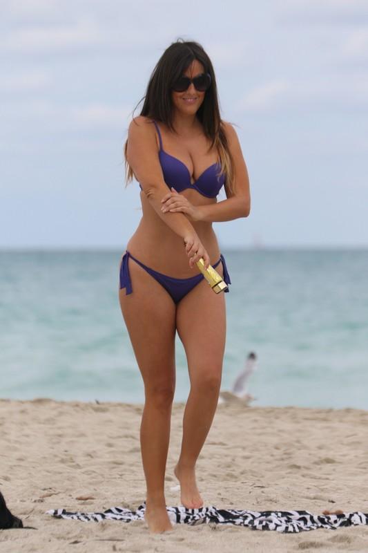 beautiful female Claudia Romani in a purple bikini