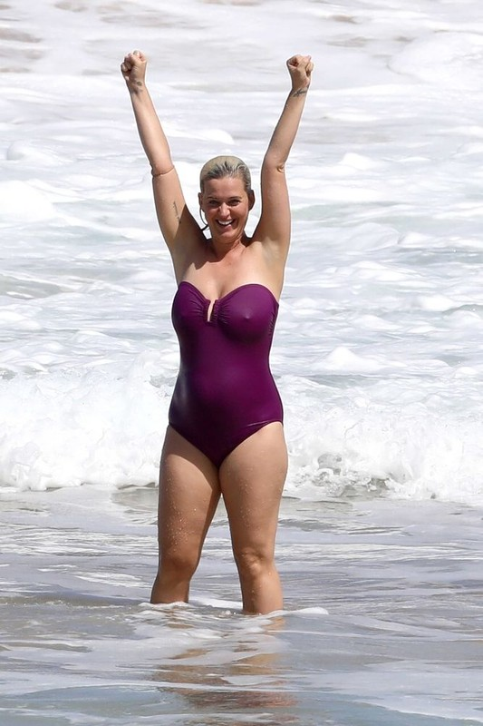 cheerful babe Katy Perry in wet purple swimsuit