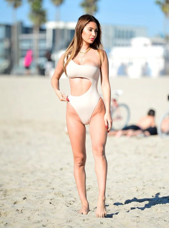 gorgeous lady Francesca Farago in one piece swimsuit