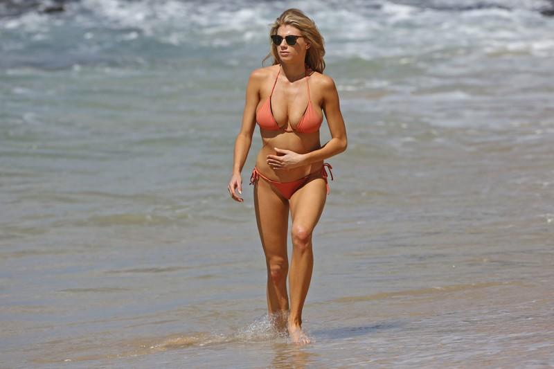 blonde model Charlotte Mckinney in orange bikini
