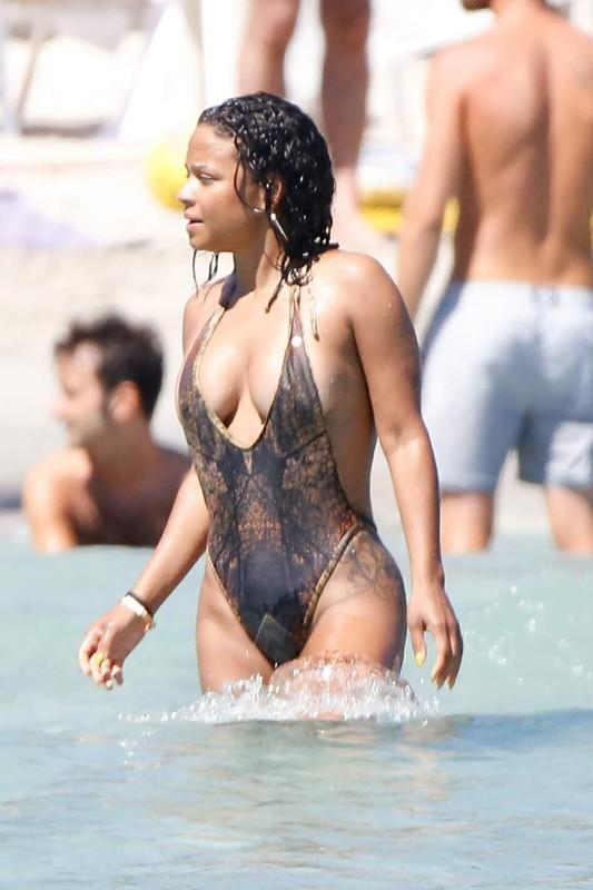 ebony hottie Christina Milian in wet swimsuit